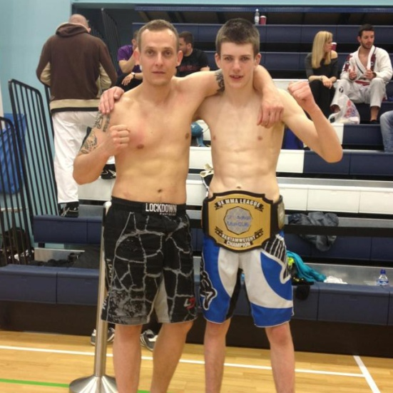 Ben (right) with his UK MMA League title