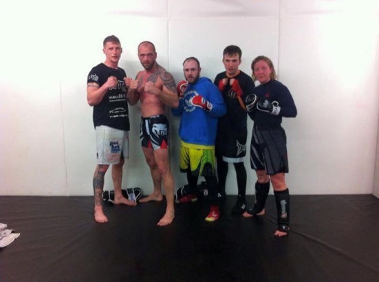 Chris, in blue, with his team mates (Credit: Wolverhampton MMA)